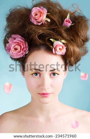 Beautiful girl with Spring make up and roses.Colorful makeup. Colorful pink and yellow eyeshadow. - stock photo