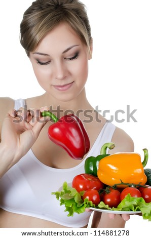Beautiful girl with vegetables isolated on white - stock photo