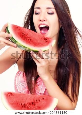 Beautiful girl with watermelon in studio - stock photo