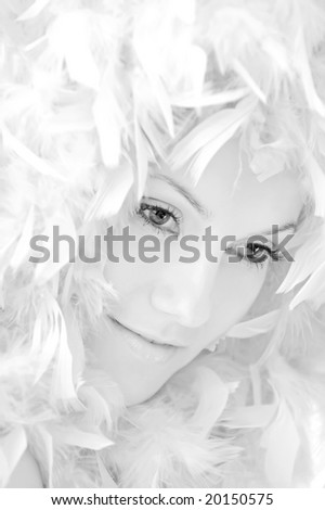 beautiful girl with white feathers - stock photo