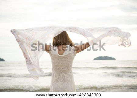 Beautiful Girl With White Scarf on The Beach. Travel and Vacation. Freedom Concept