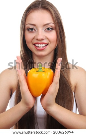 Beautiful girl with yellow pepper, isolated on white