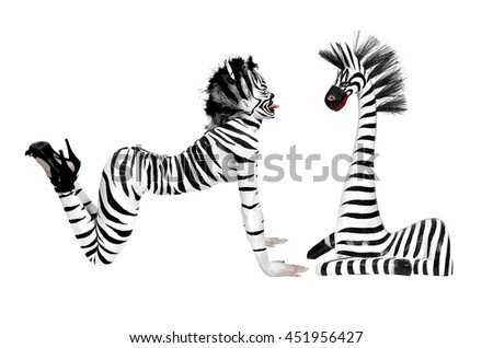 beautiful girl with zebra body paint sticking out his tongue to a zebra wood