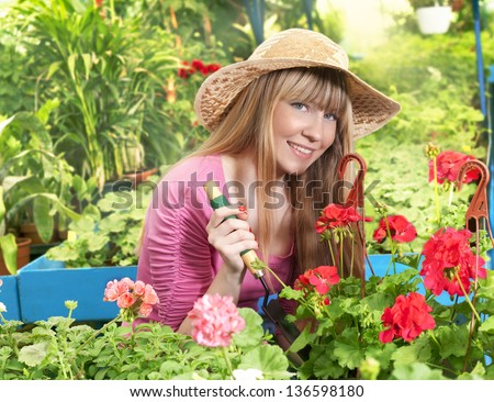 beautiful girl working in a greenhouse