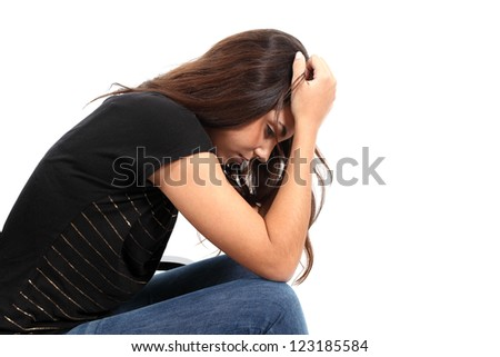 Beautiful girl worried seated with her hands on the head in a white isolated background - stock photo