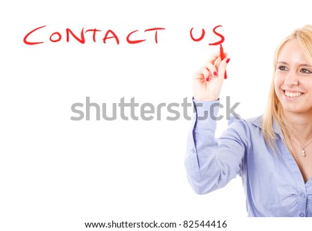 "Beautiful girl writing ""contact us"" on the screen - stock photo"