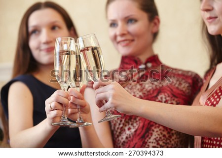 beautiful girls at a Christmas party with glasses of champagne