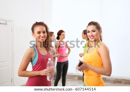 Beautiful girls chatting in gym