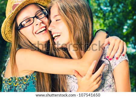 Beautiful Girls Having Fun in the Park - stock photo