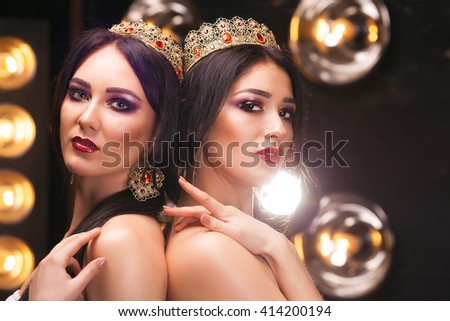 beautiful girls in crowns with perfect make up - stock photo