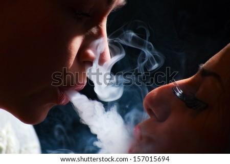 beautiful girls in smoke with hookah - stock photo