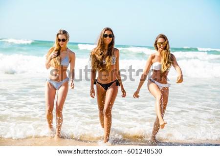 Beautiful Girls In The Beach Having Fun On The Water