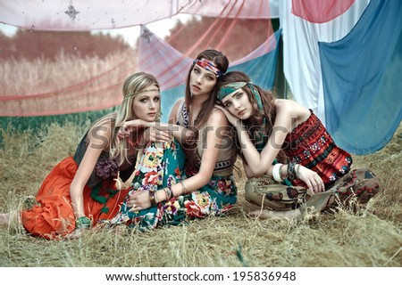 Beautiful girls of hippie in the field - stock photo