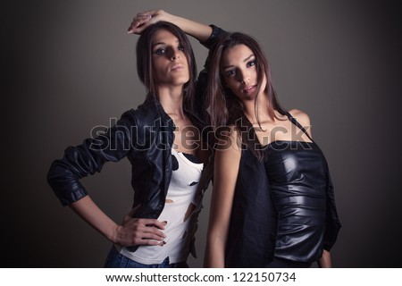Beautiful girls posing, in rock and roll style - stock photo