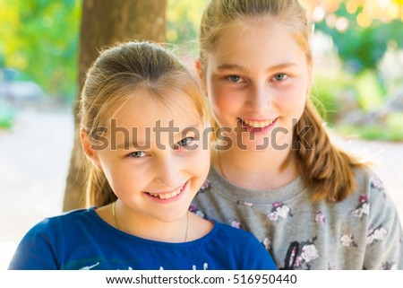 beautiful girls walking in the summer park