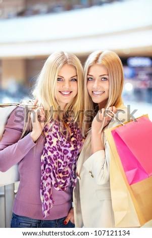Beautiful girls with shopping bags - stock photo