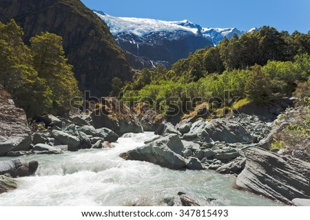 Beautiful glacial river running off hanging Rob Roy Glacier in Mount Aspiring National Park, Southern Alps, New Zealand