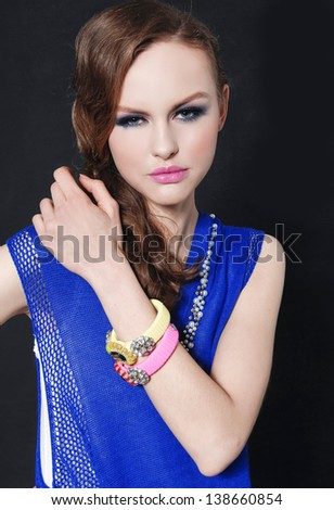 beautiful glamour girl with bright make-up-and color bracelet - stock photo