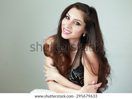 beautiful glamour portrait of brunette woman in natural light studio