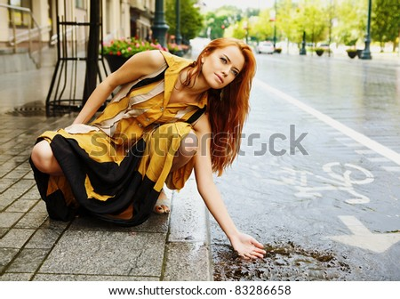 Beautiful glamour red-haired woman outdoor. - stock photo