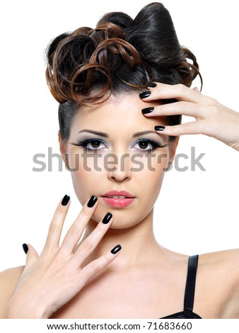 Beautiful glamour woman with modern hairstyle and black nails. Fashion eye make-up