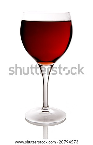 beautiful glass filled with red wine on white