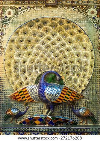 Beautiful glass mosaics of peacocks at Udaipur City Palace in Rajasthan, India. Constructed by Sajjan Singh. - stock photo