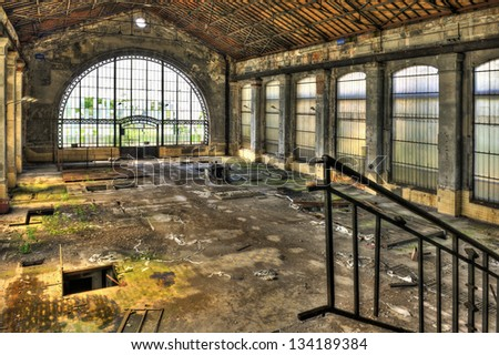 Beautiful glass wall inside the hall of an abandoned coal mine - stock photo