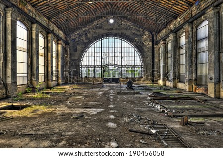Beautiful glass wall inside the hall of an abandoned coal mine, hdr processing - stock photo