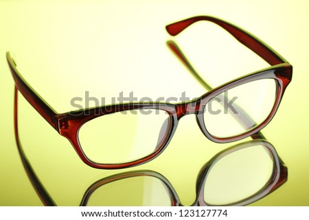 Beautiful glasses on green background