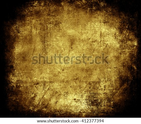 Beautiful gold abstract vintage grunge background with faded central area for your text or picture, scratched scary background with frame - stock photo