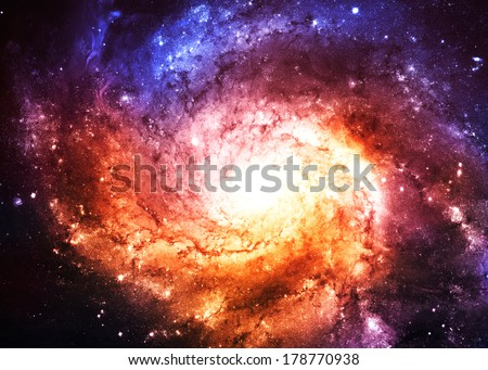 Beautiful Gold and Blue Galaxy - Elements of this Image Furnished by NASA - stock photo