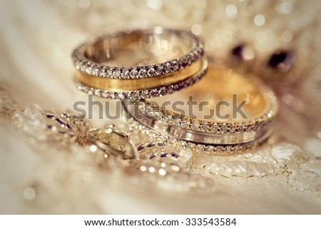 Beautiful gold background with wedding rings and stars - stock photo