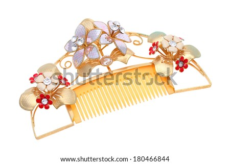 beautiful gold comb isolated on white background - stock photo