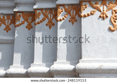 Beautiful gold floral pattern on the wall in Swayambhunath Nepal in the capital Kathmandu on a white background