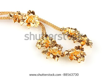 beautiful gold necklace and earrings isolated on white