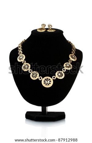 beautiful gold necklace with diamond and earrings on mannequin isolated on white - stock photo