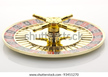 Beautiful gold roulette on a white background. - stock photo