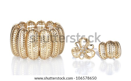 Beautiful golden bracelet and rings isolated on white - stock photo