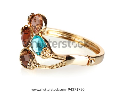 Beautiful golden bracelet with precious stones isolated on white - stock photo