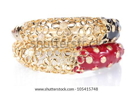Beautiful golden bracelets isolated on white - stock photo