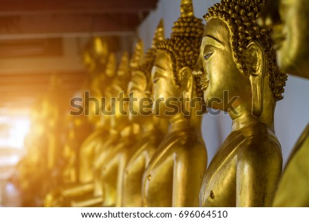 Beautiful Golden Buddha Many statues in buddhist temple.