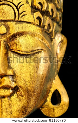 Beautiful Golden Buddha's Head Mask on Black View of Side.