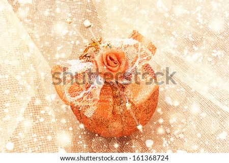 beautiful golden christmas ball on a shiny background