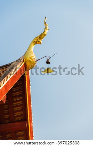 Beautiful golden gable apex as king of Nagas decorate on the roof of Thai Temple - stock photo