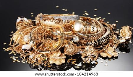 Beautiful golden jewelry on grey background - stock photo