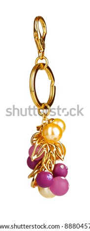 beautiful golden keychain with precious stones isolated on white