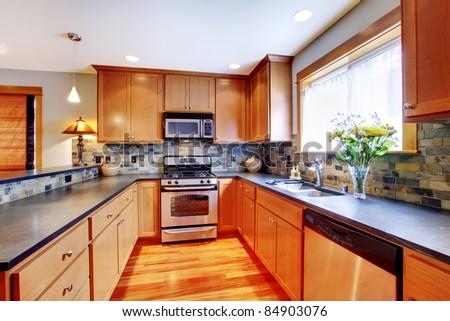 Beautiful golden kitchen - stock photo