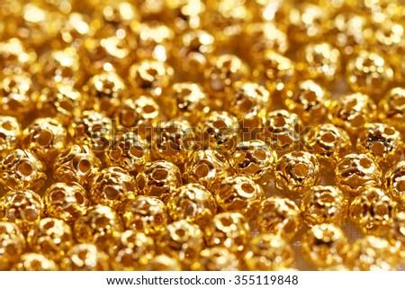 Beautiful golden metal beads - closeup photo - stock photo