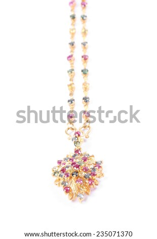 Beautiful golden necklace with precious stones isolated on white - stock photo